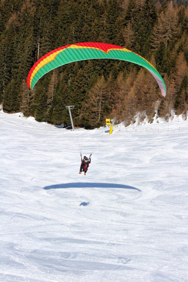 FLYING THROUGH THE ALPS PARAGLIDING IN AUSTRIA snow view