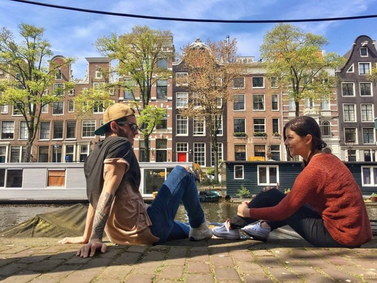 6 TIPS TO MAKE THE MOST OF TRAVELING AS A COUPLE taking-in-the-view-amsterdam