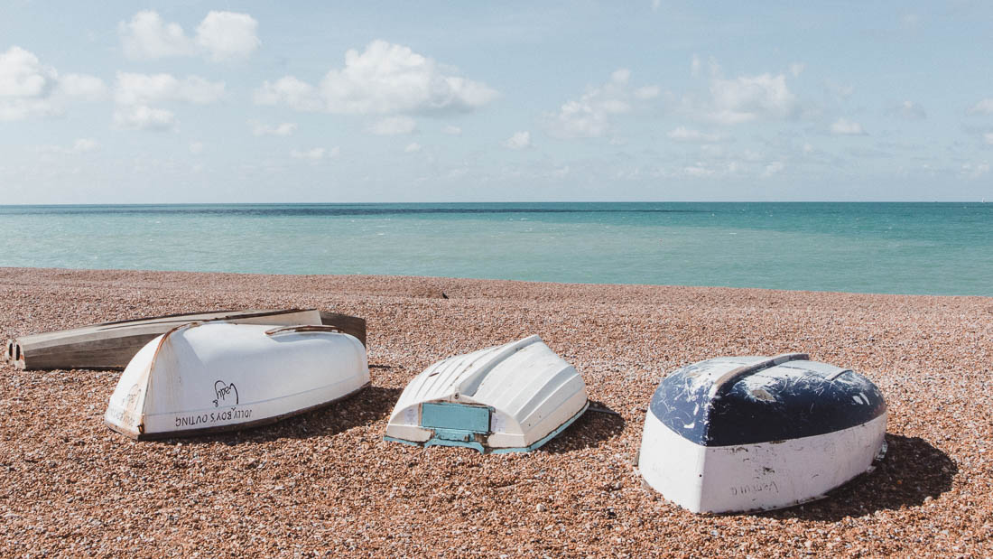 Overturned boats on sandy beach