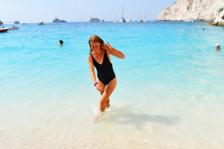 Walking in water at Navagio Beach