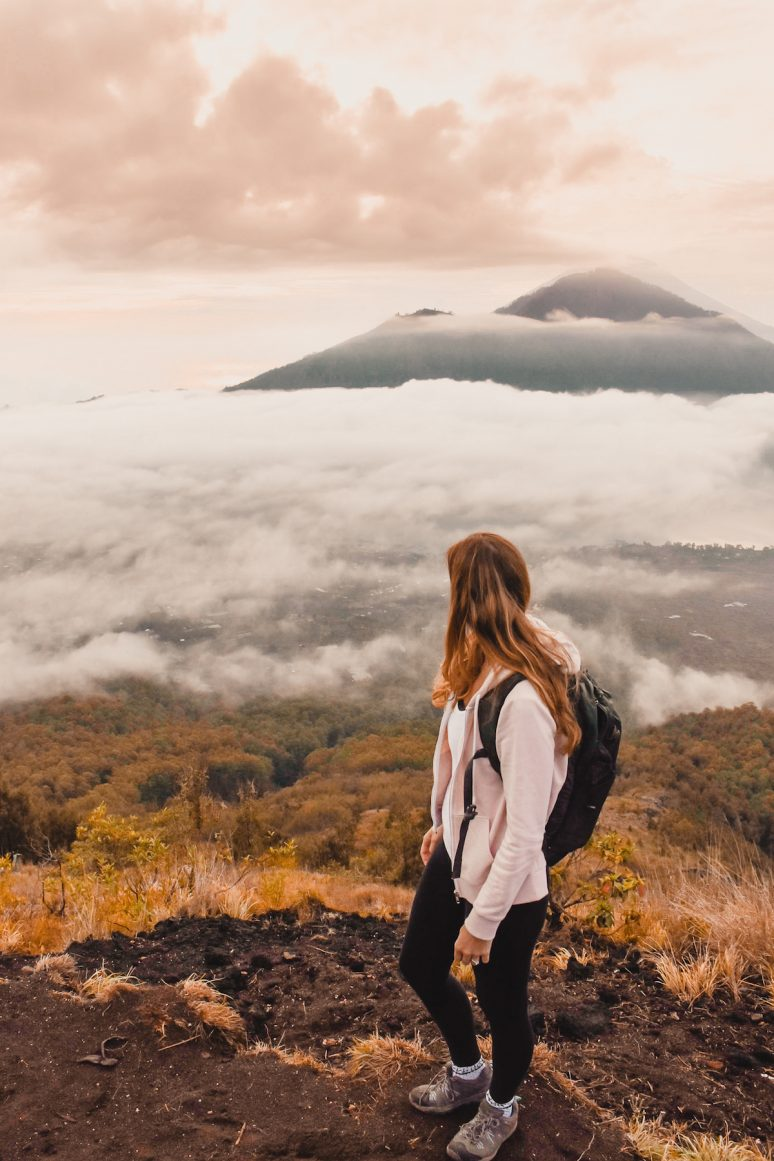 Woman Overlooking Sunrise On Mount Batur in Bali