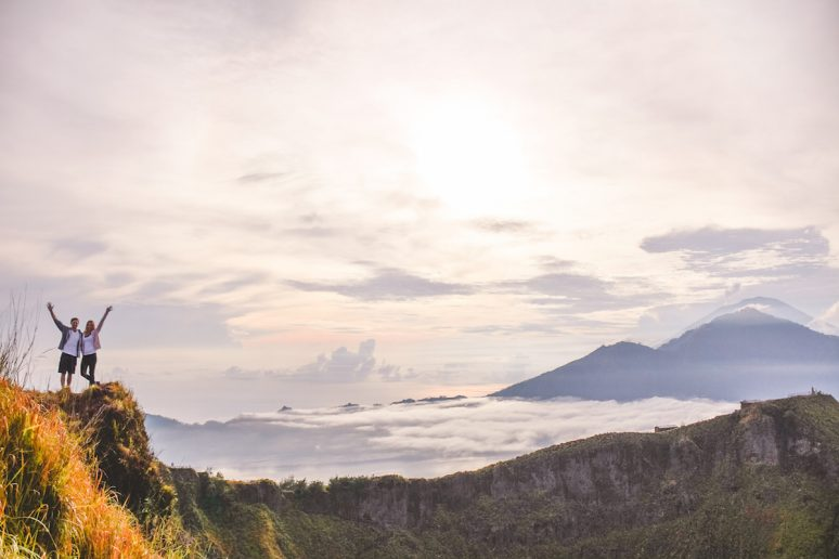 View From Mount Batur in Bali of Couple and Mount Agung