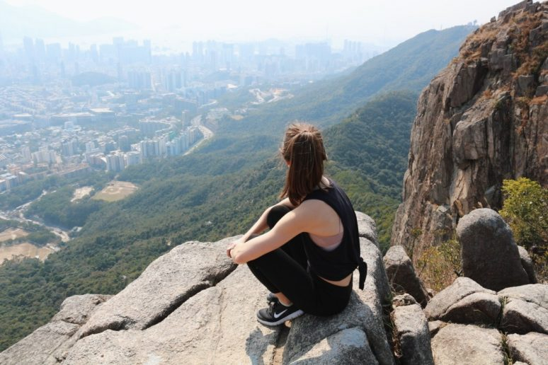 Woman on top of Lion Rock Hike in Hong Kong