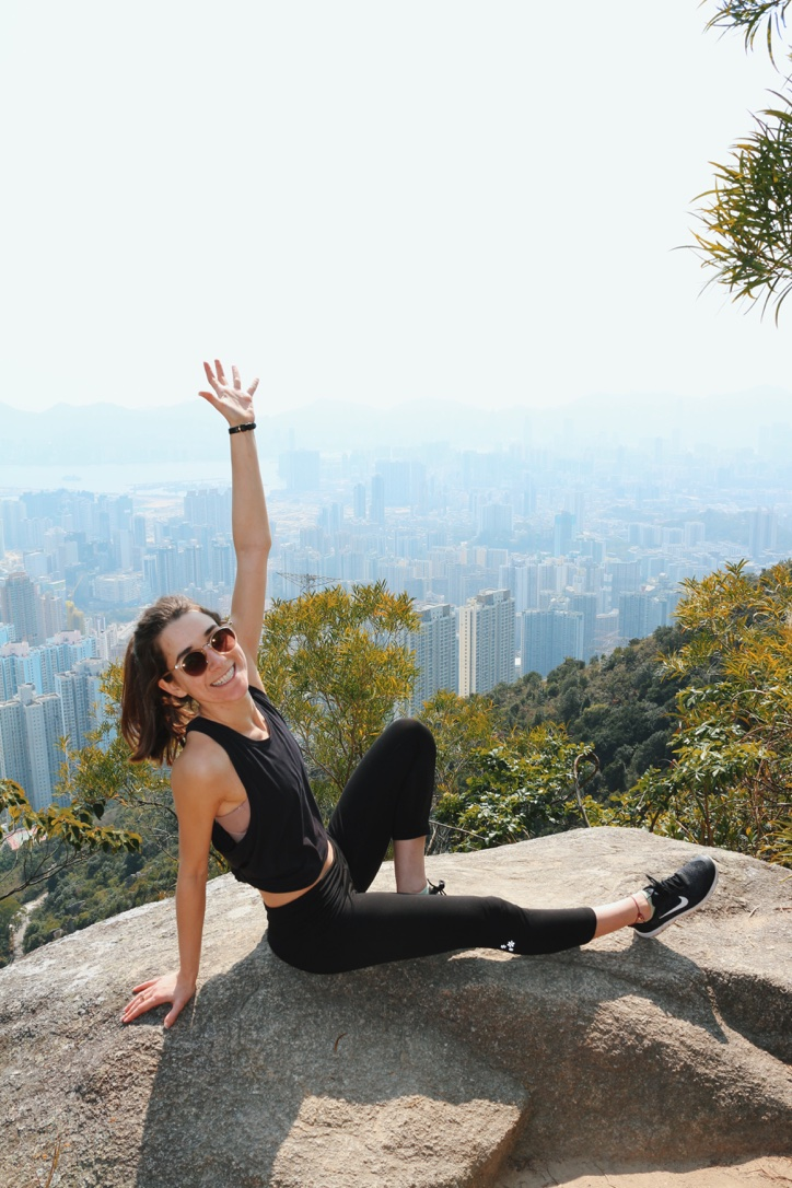 Woman posing on top of Lion Rock Hike in Hong Kong