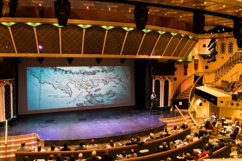 Lecture hall on Carnival cruise ship with Alaska map