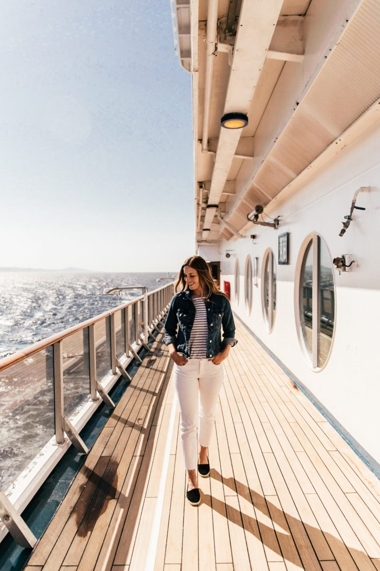 Woman walking on deck of cruise ship