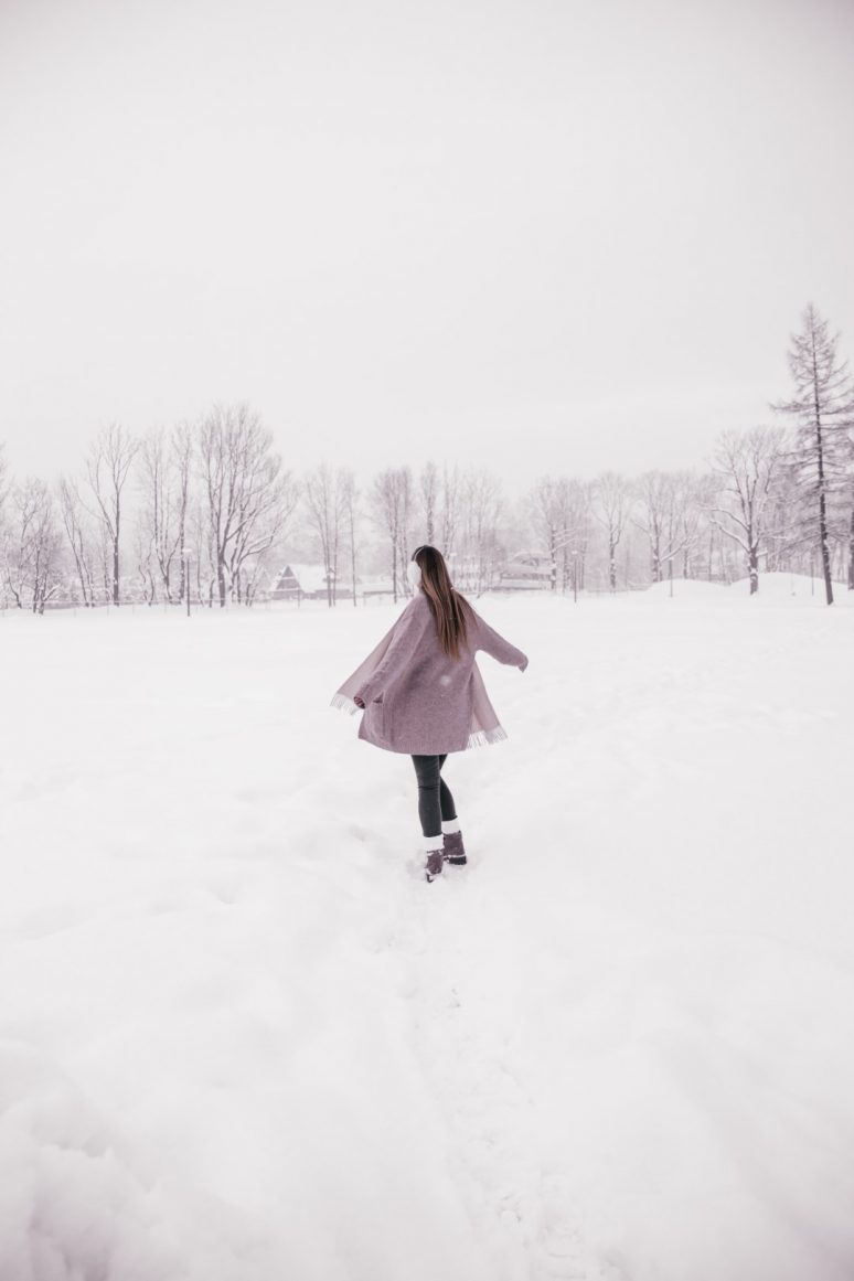 Woman in snow field in Zakopane, Poland