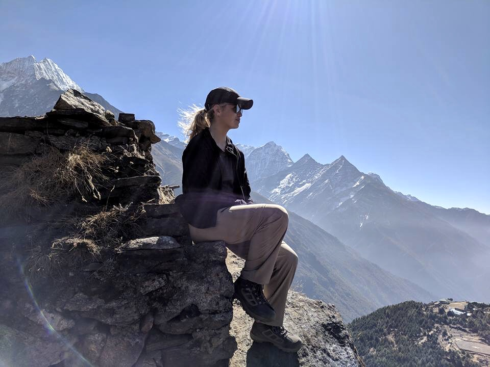 13 Reasons To Trek Mount Everest Base Camp Woman On Rock