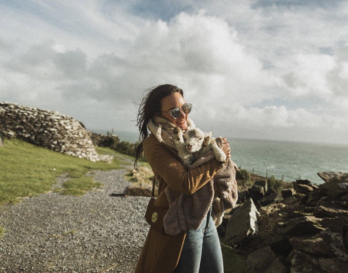Woman Holding Baby Lamb Ireland