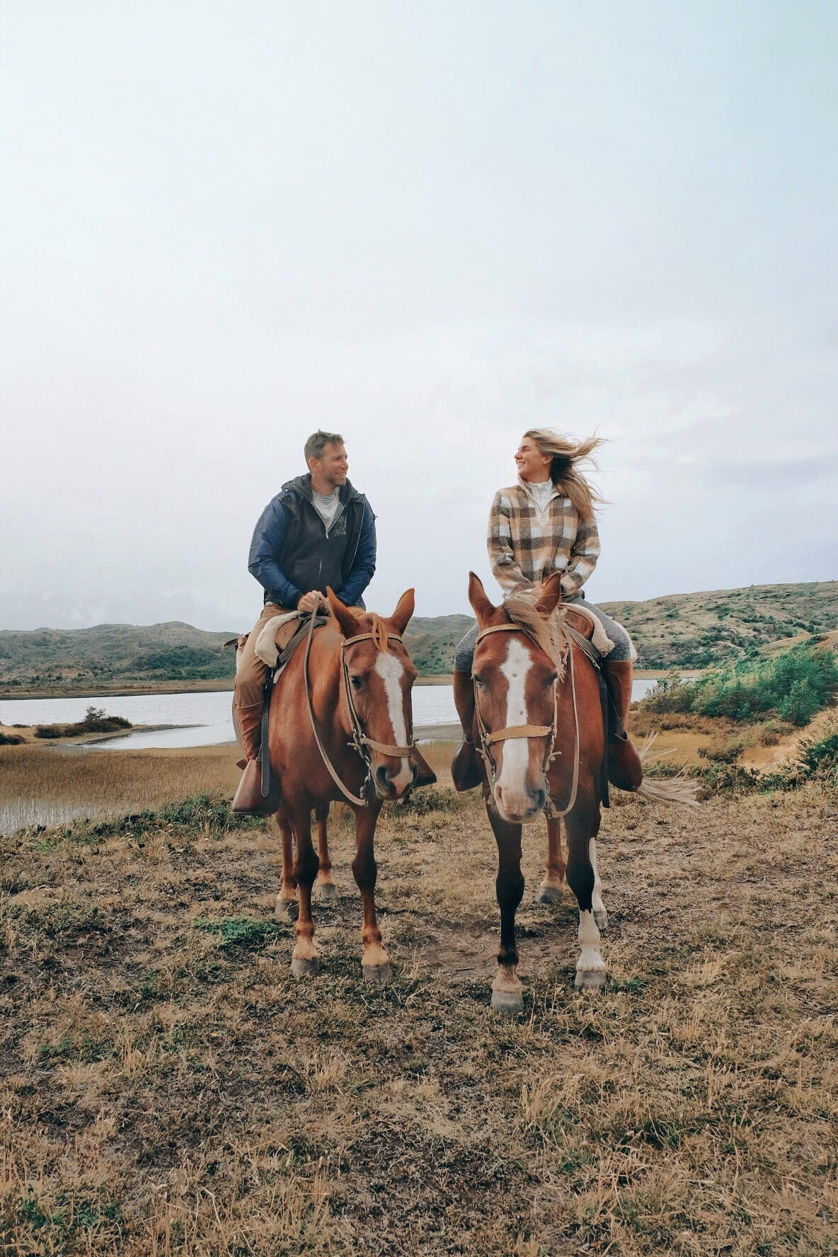 Couple Horseback Riding In Torres del Paine Patagonia