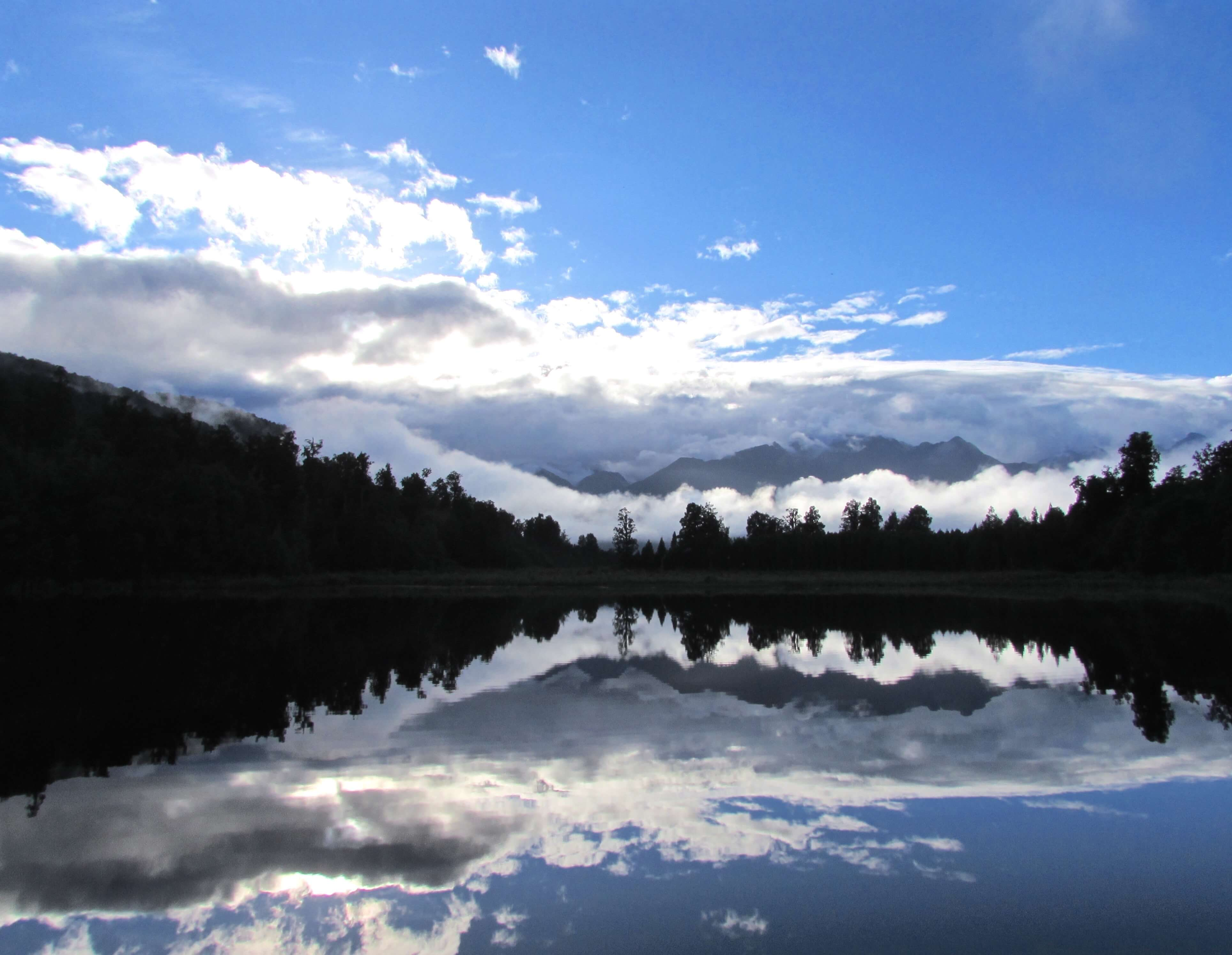 Lake Matheson reflecting trees and mountains