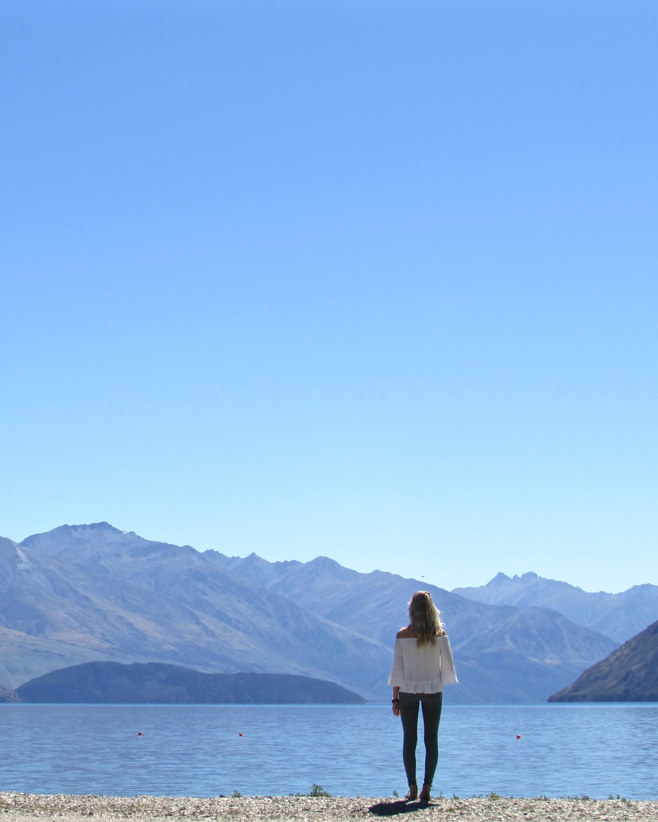 Woman in front of Lake Wanaka in New Zealand