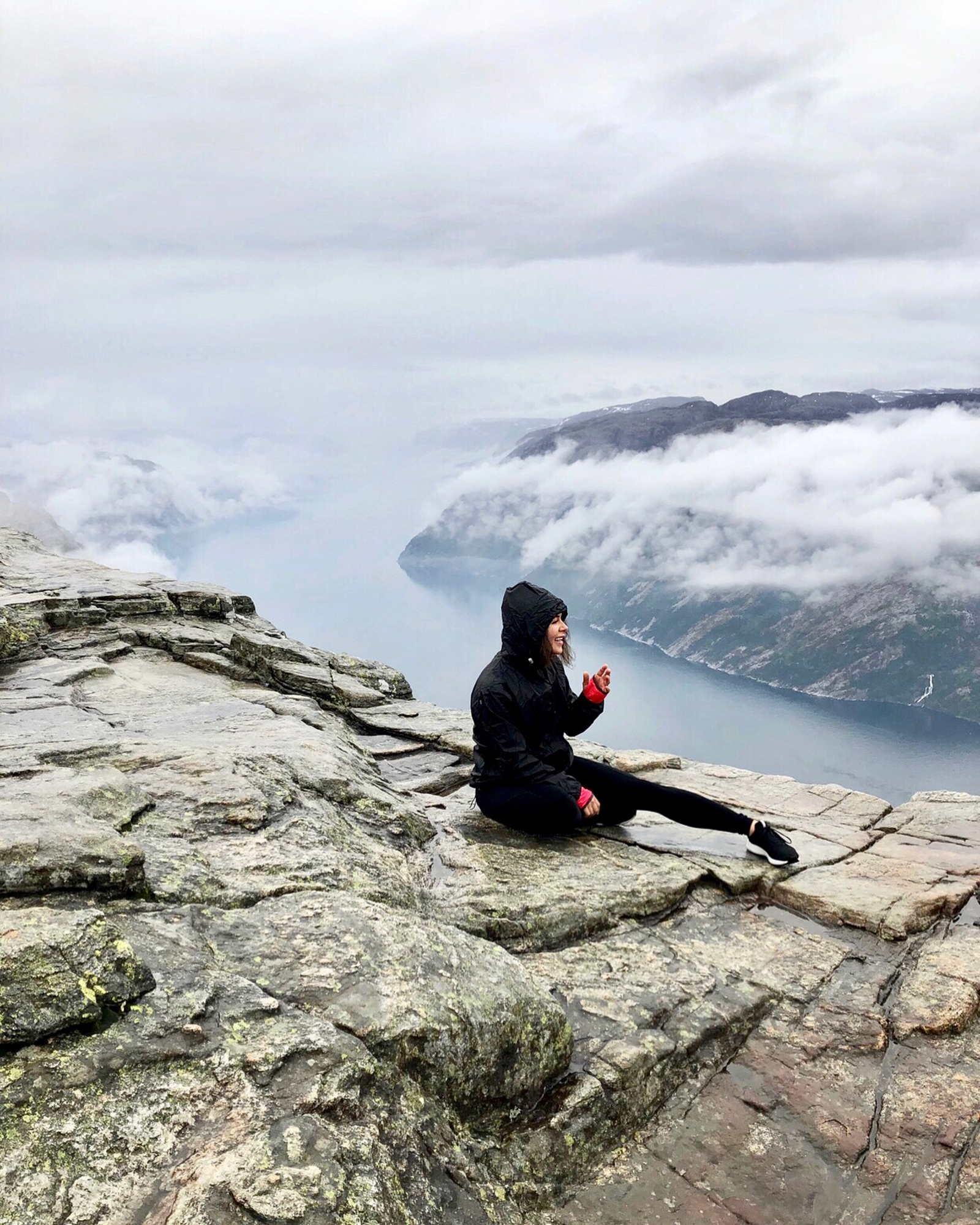 Wearing raincoat for hiking preikestolen pulpit rock