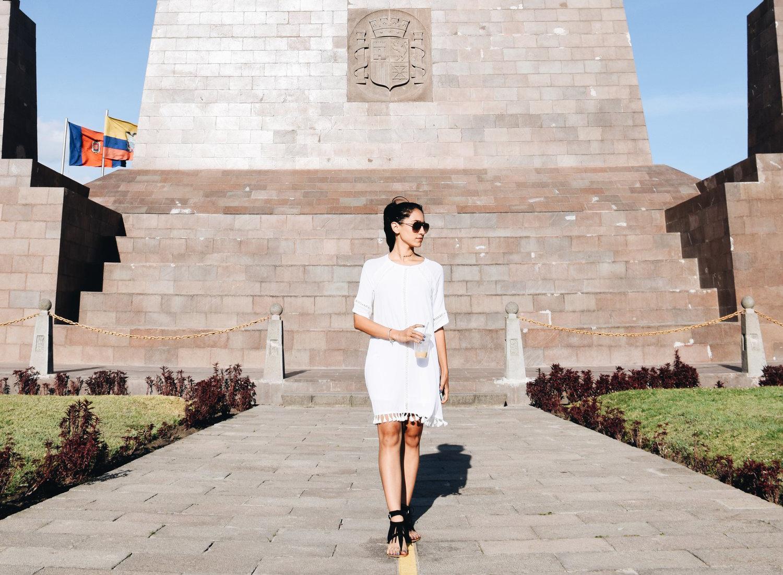 Woman in front of Mitad del Mundo