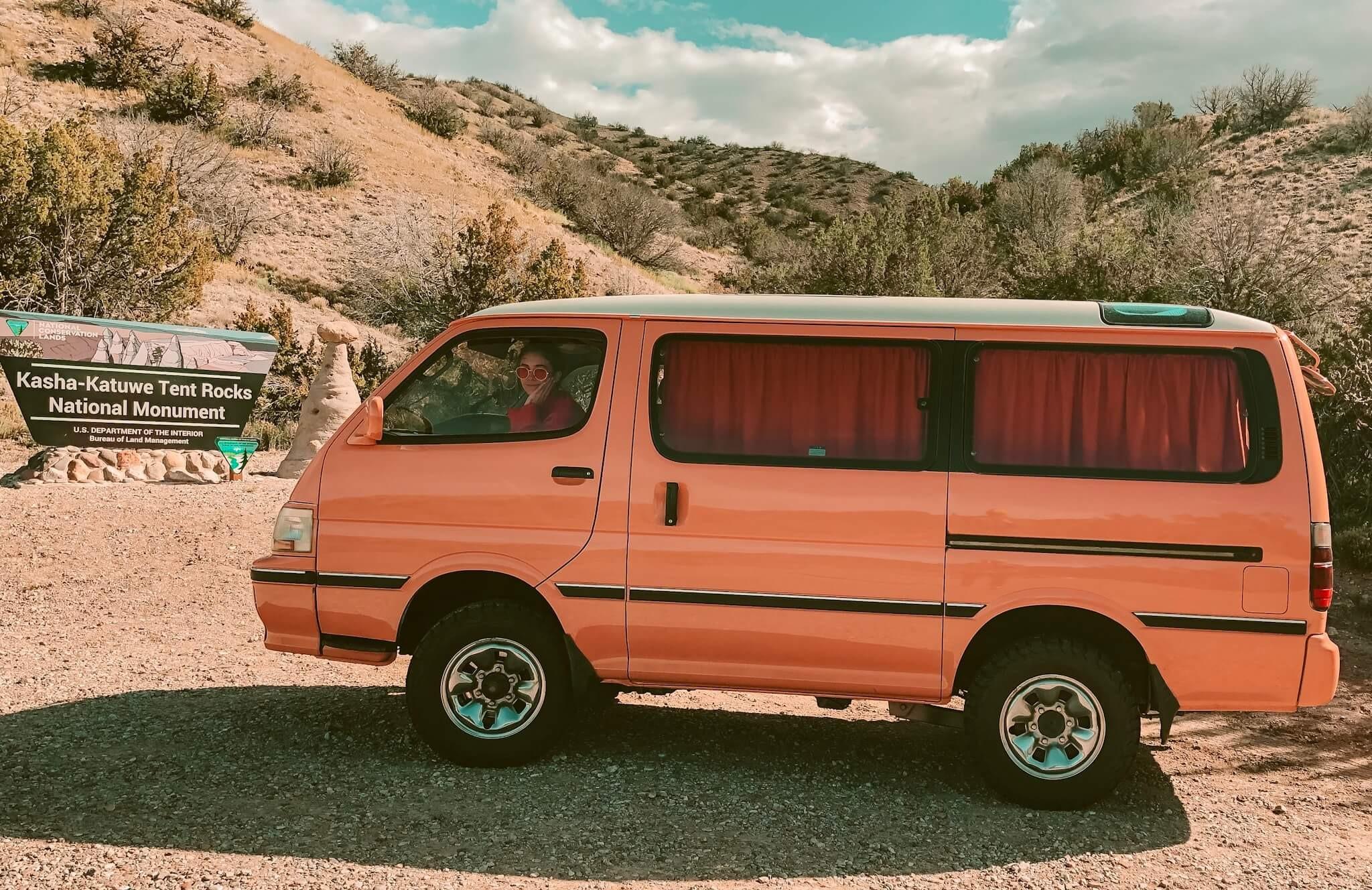 Orange van in front of Kasha-Katuwe Tent Rocks National Monument