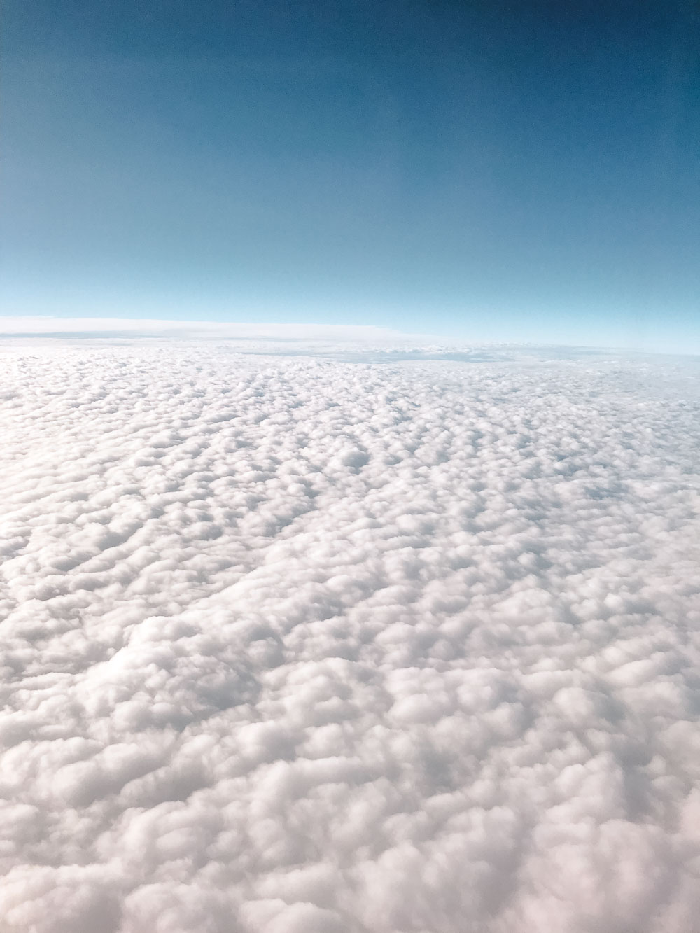 Flying in an airplane above the clouds