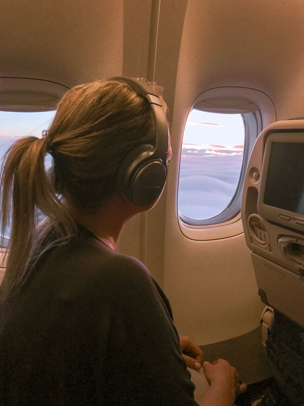 Woman with noise cancelling headphones to help with fear of flying