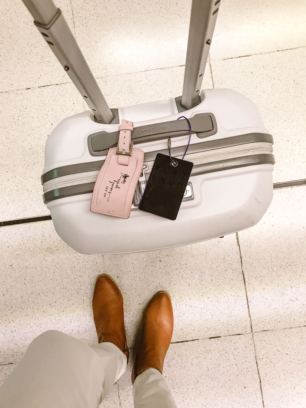 Samsonite luggage with We Are Travel Girls pink luggage tag
