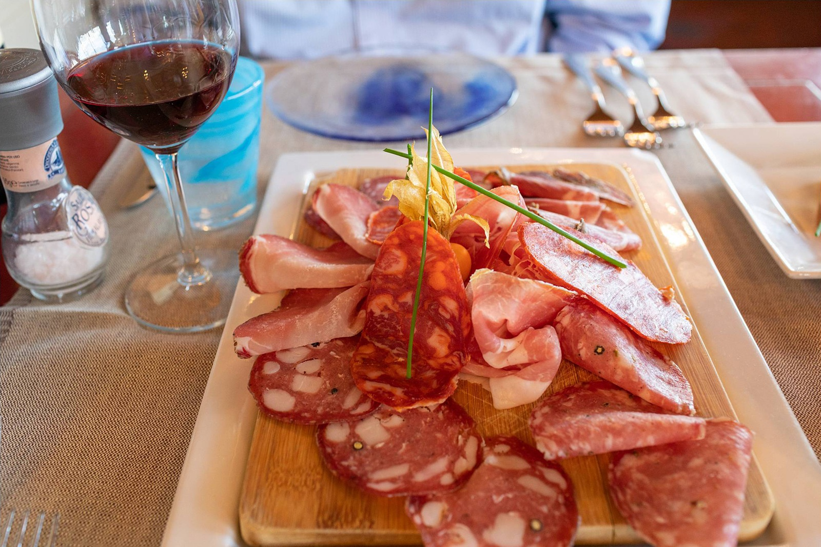Charcuterie board and red wine