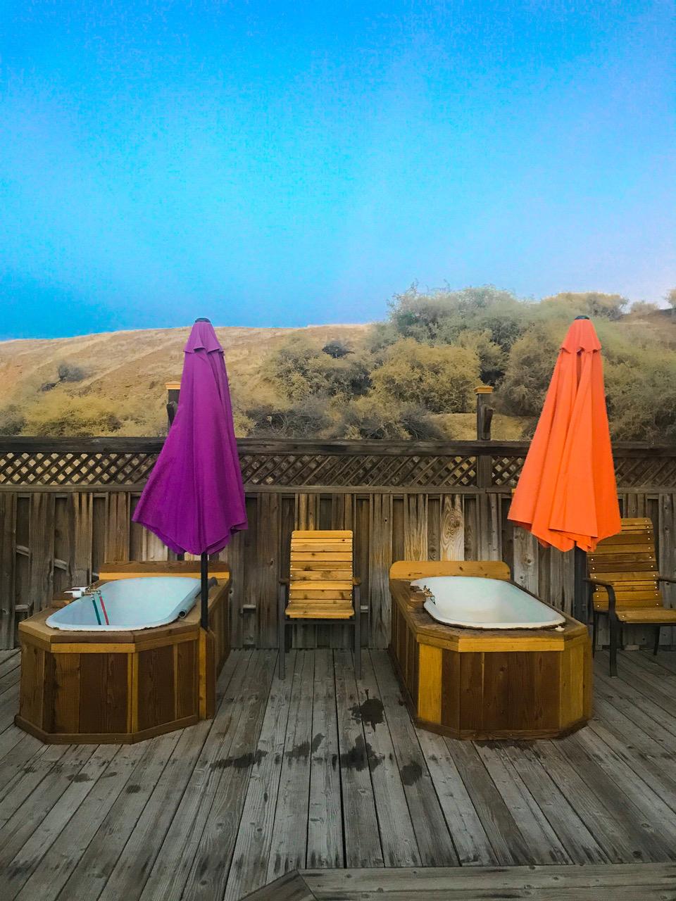 Purple and orange umbrellas and hot tubs