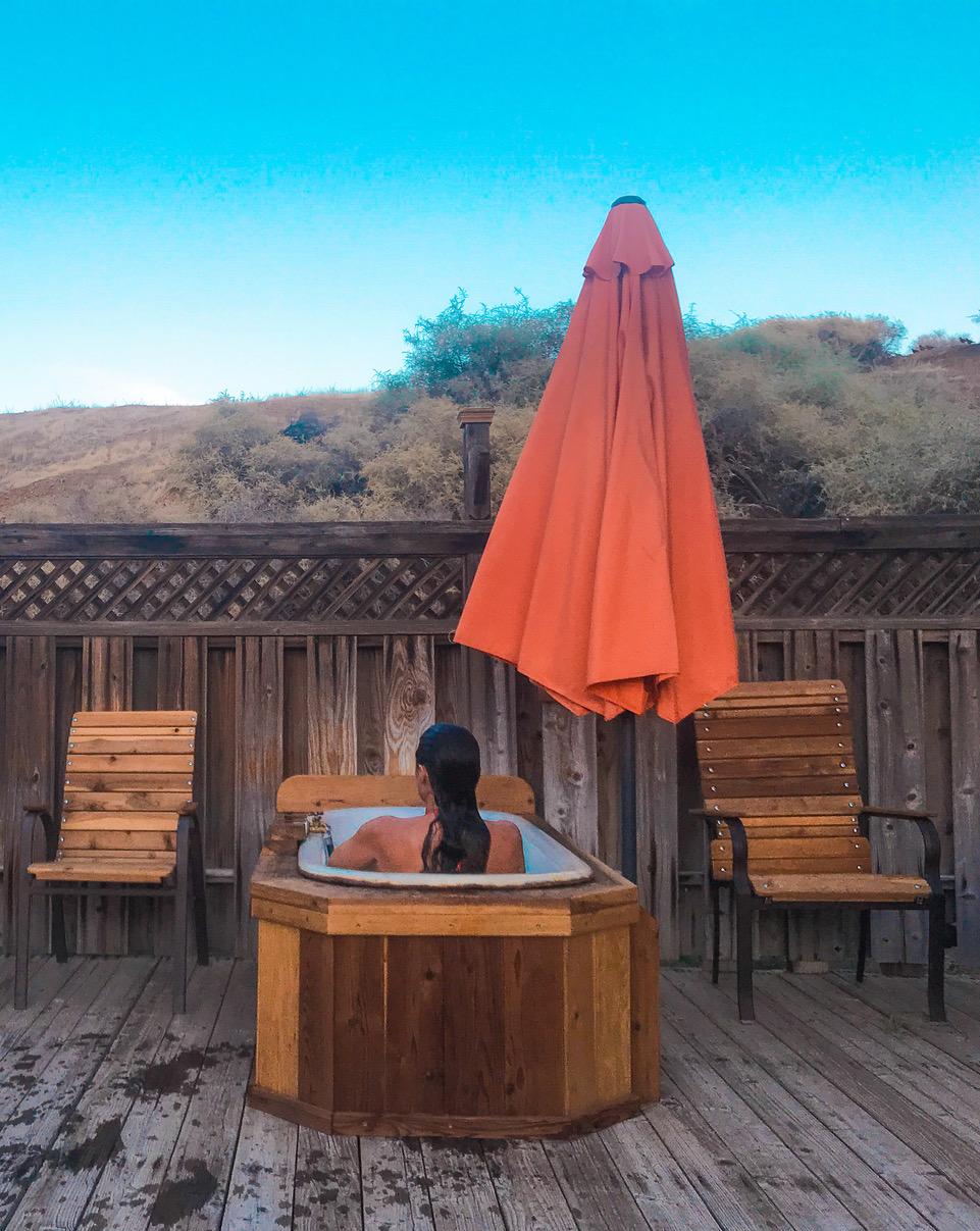 Woman in hot tub at Mercey Hot Springs
