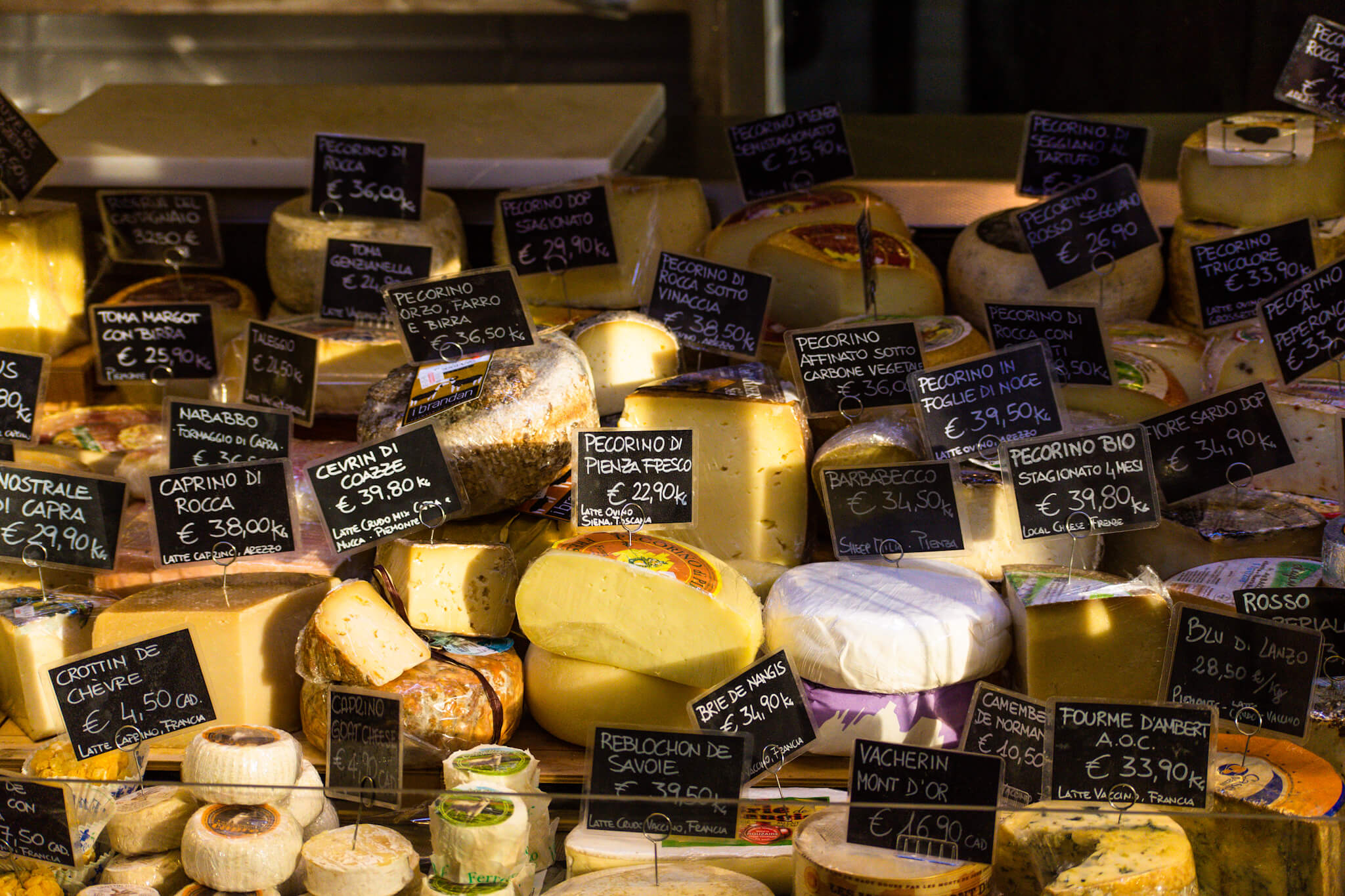 Image of a market stall selling cheese in Florence