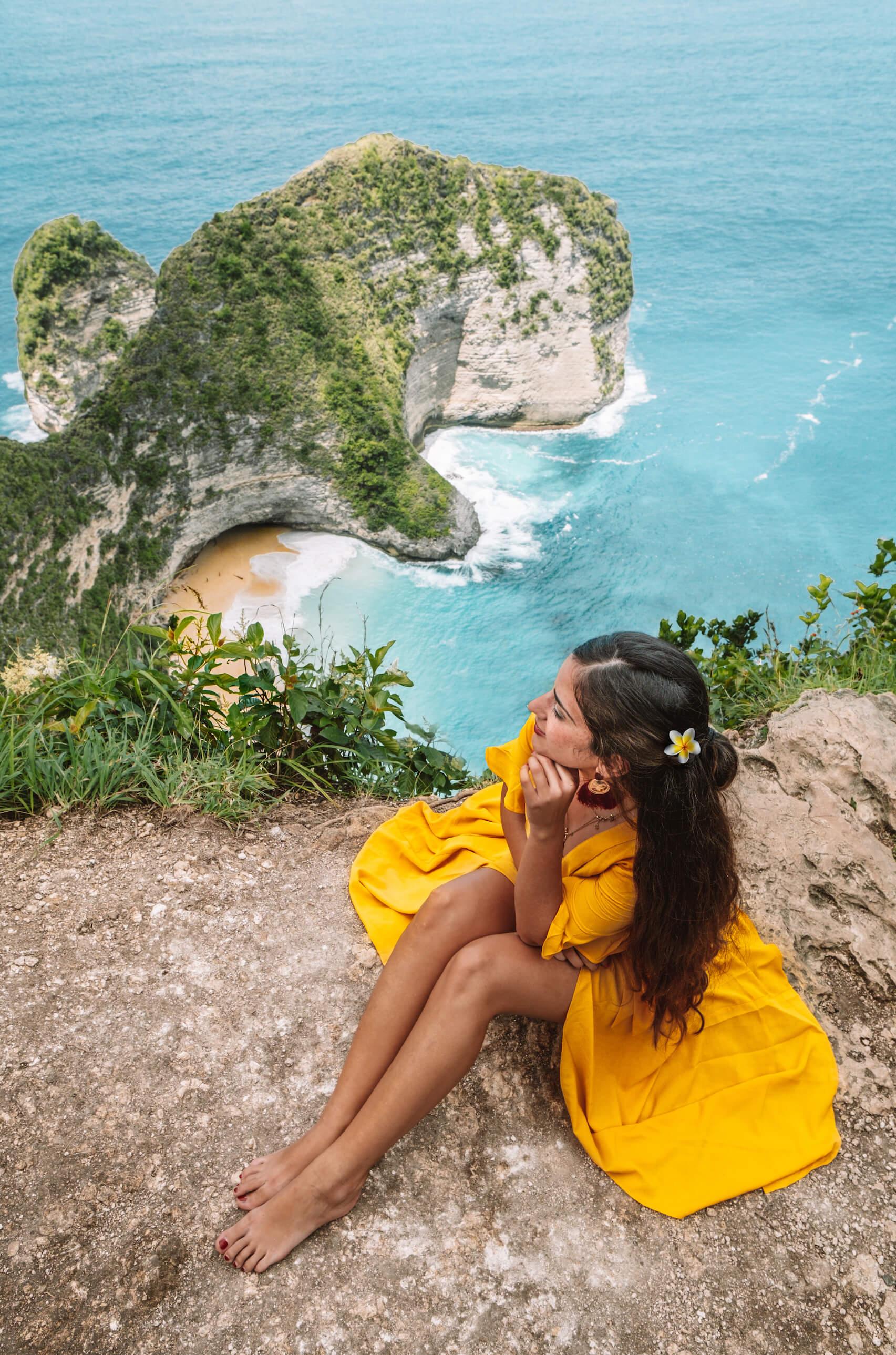Woman in yellow dress at Kelingking Beach Lookout