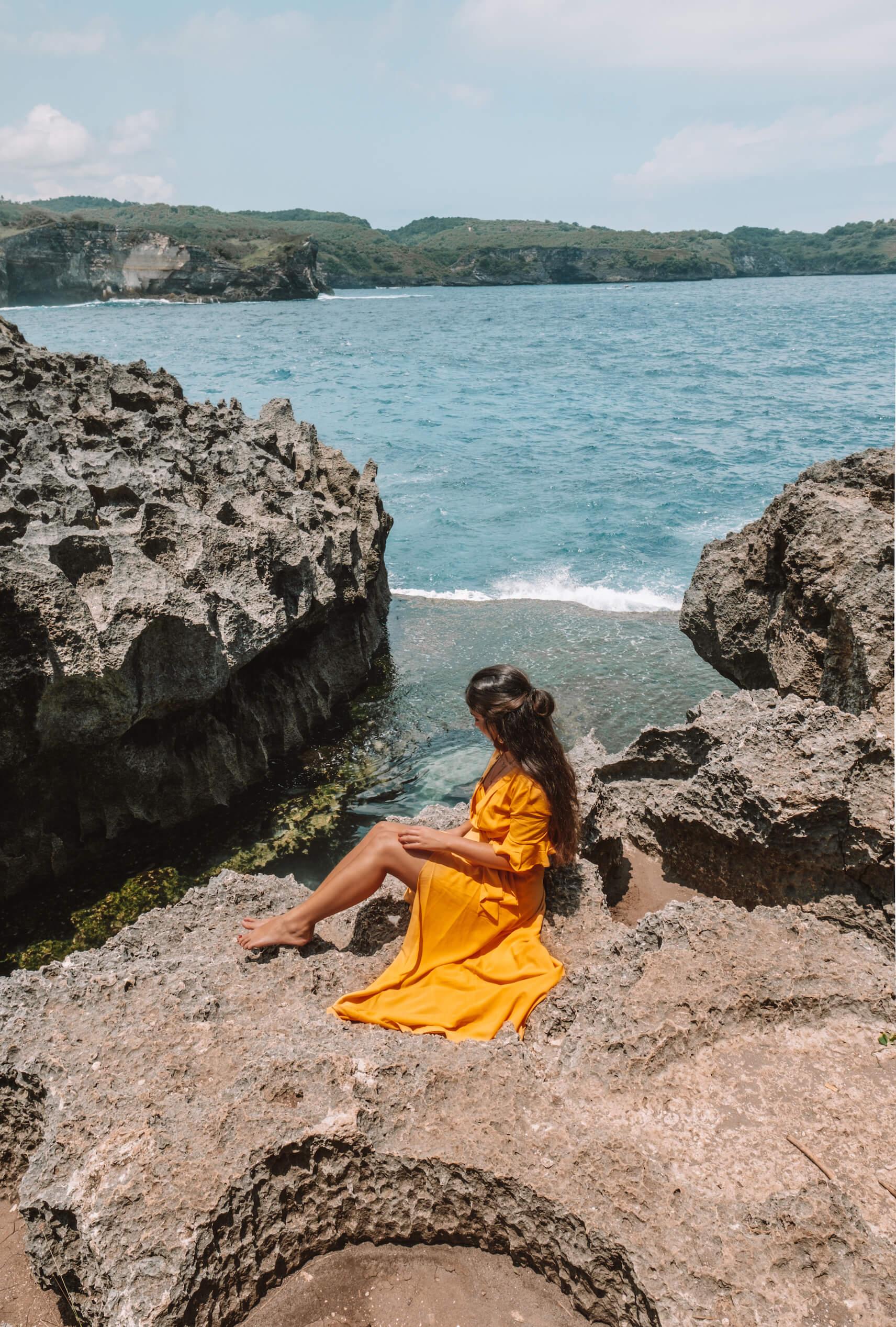 Woman on rocks at Angel's Billabong beach