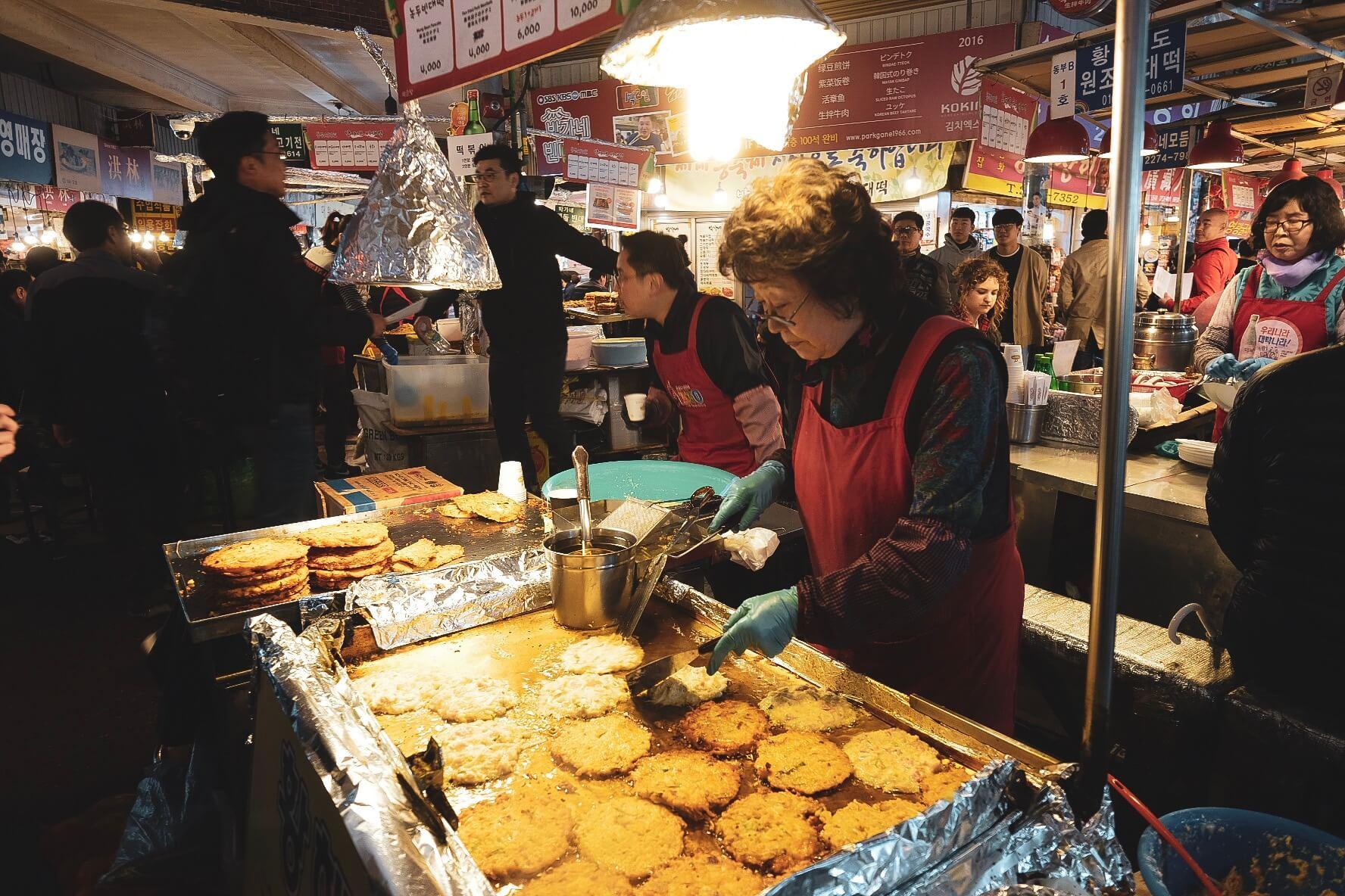 Woman making vegetarian pancakes in South Korea