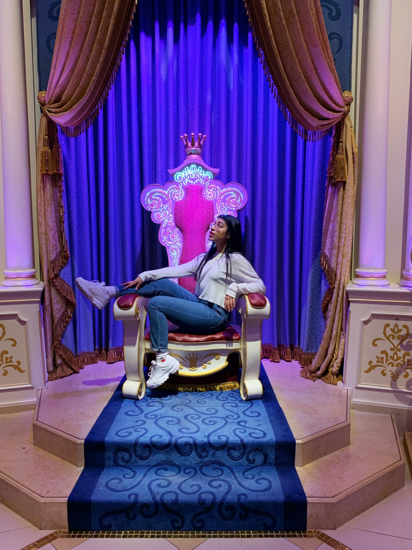 Woman on pink throne at Tokyo Disney