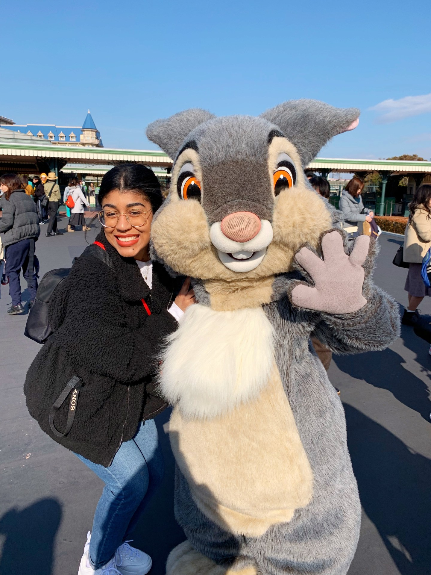 Woman with rabbit character at Tokyo Disney