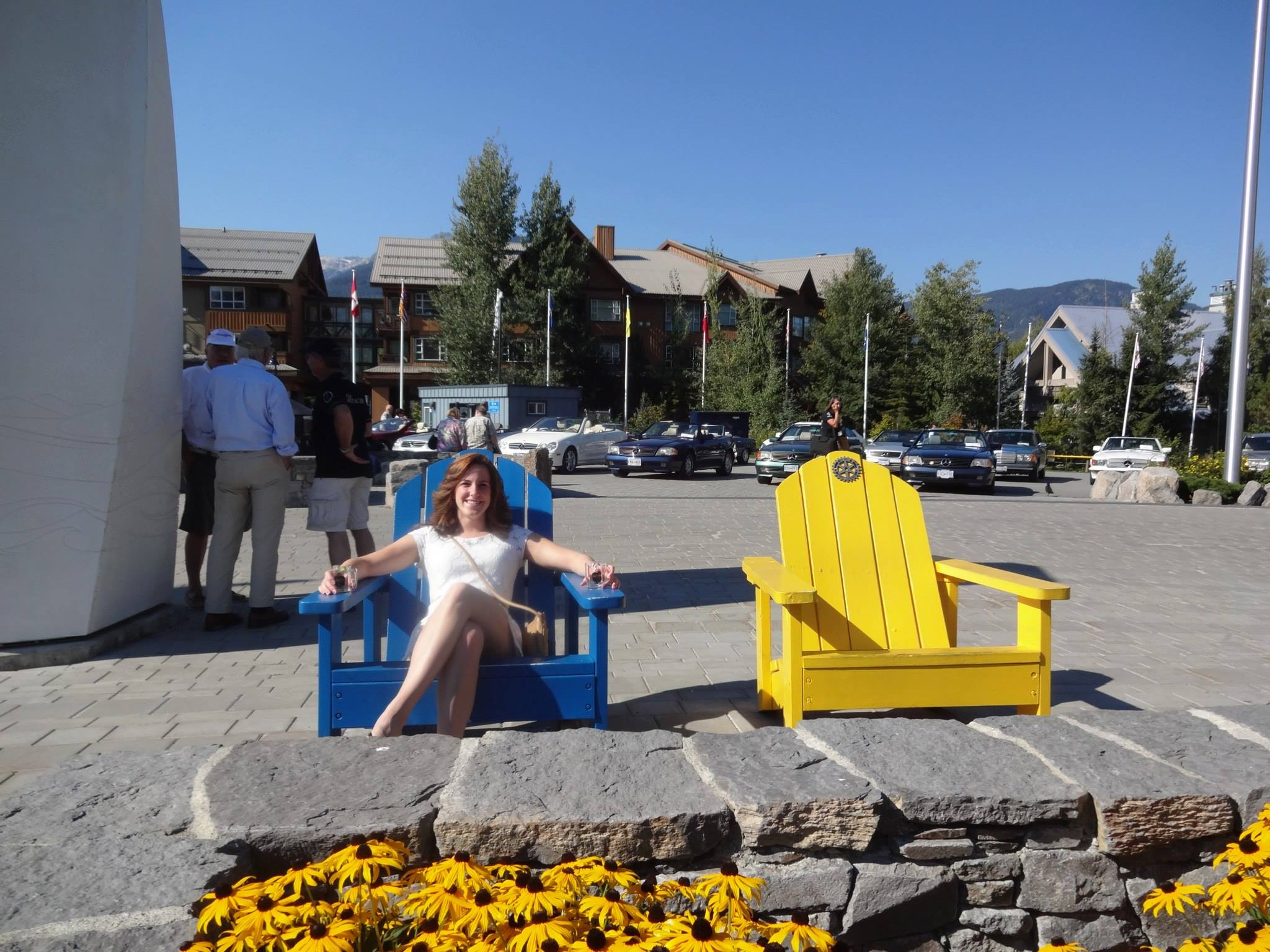 Woman in blue chair at Whistler village